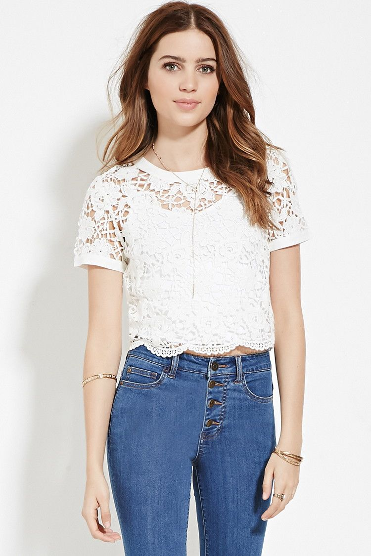 0e29af5ccc A sheer knit floral crochet top with short sleeves