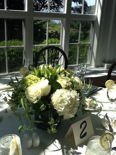 Centerpieces that were created for a 50th wedding anniversary party. Party by New England Fine Living.