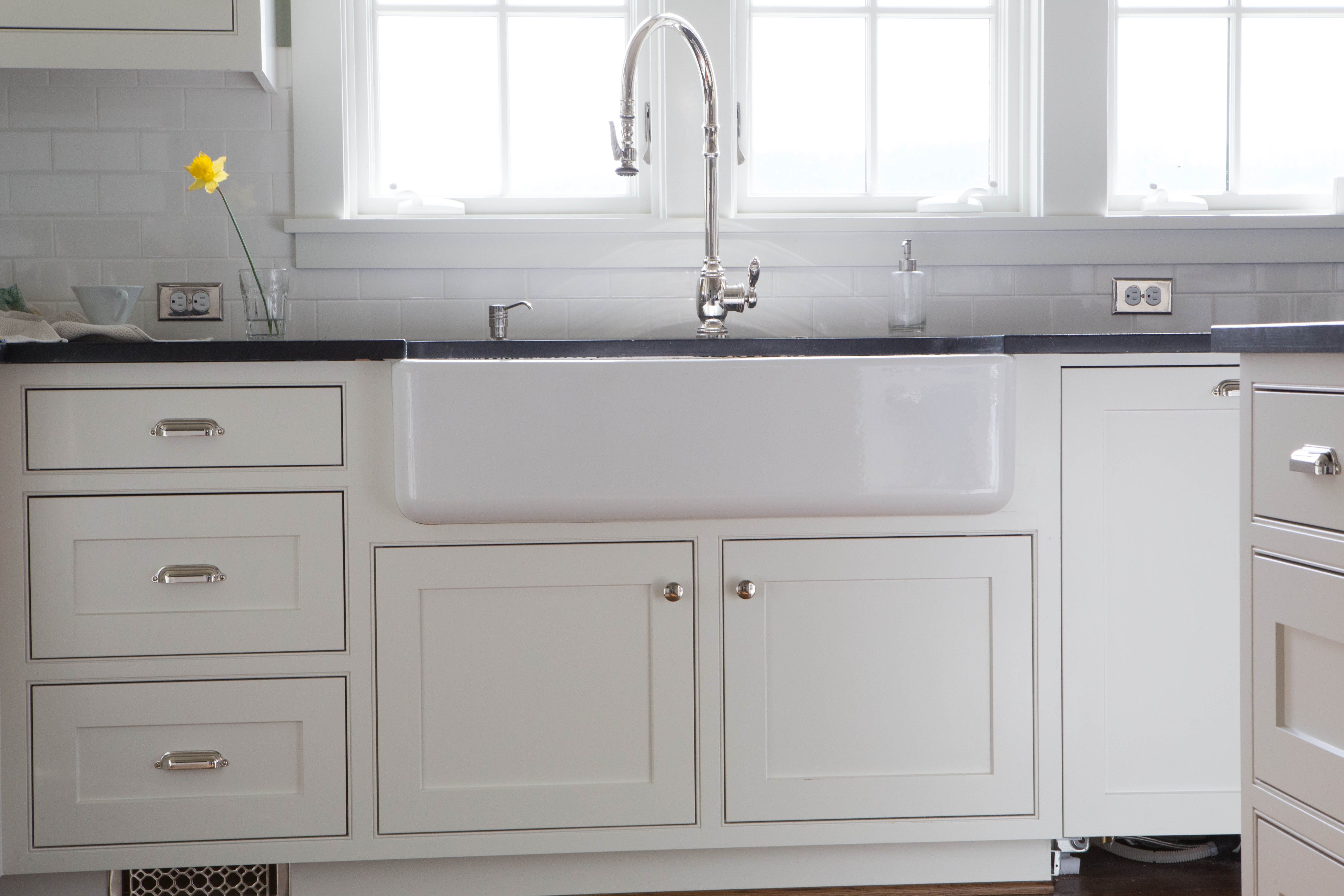 Traditional white kitchen with a farm sink. These