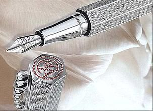 The world's most expensive pen, designed by Caran d'Ache in 1999. The pen contains solid silver parts, an 18-karat gold tip and in enveloped in 5,072 specially cut diamonds. It also contains 96 rubies which form an emblem on the pen's cap top.