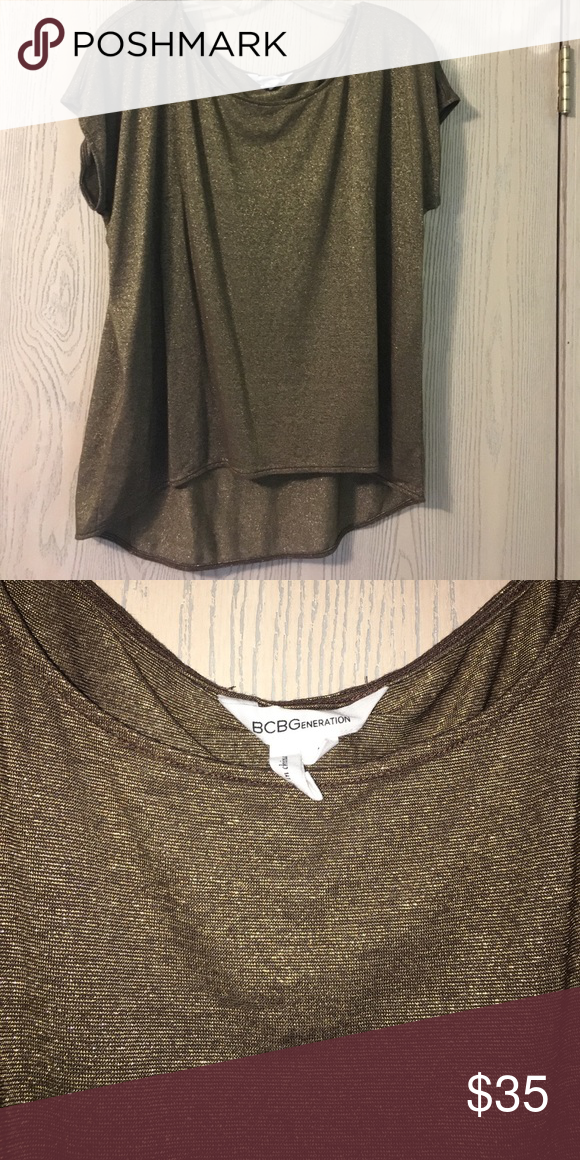 BCBGeneration sparkly gold top Gold hi-low BCBGeneration short sleeve top, size L. Very soft material Offers welcome ✨ BCBGeneration Tops Blouses