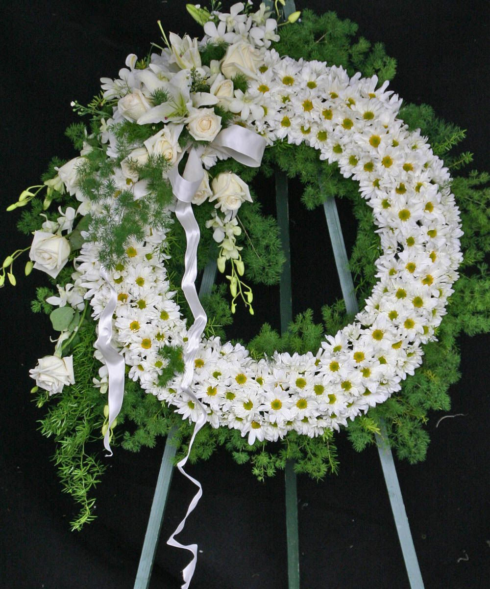 A spectacular white funeral wreath funeral flower