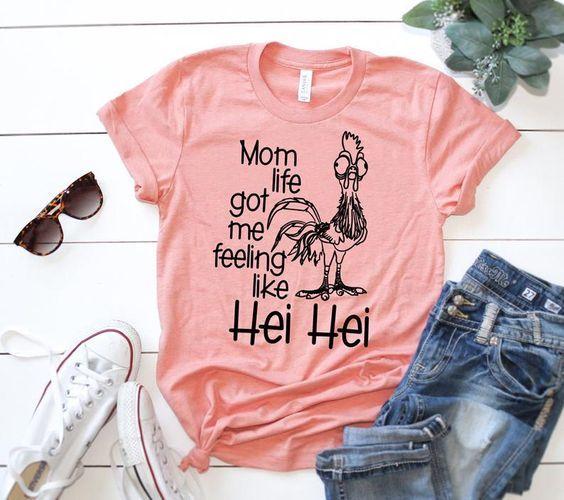 Mom Life Got Me Feeling Like Hei Hei TShirt AD01 is part of Momma shirts - Mom Life Got Me Feeling Like Hei Hei TShirt AD01 , This tshirt is Made To Order, one by one printed so we can control the quality