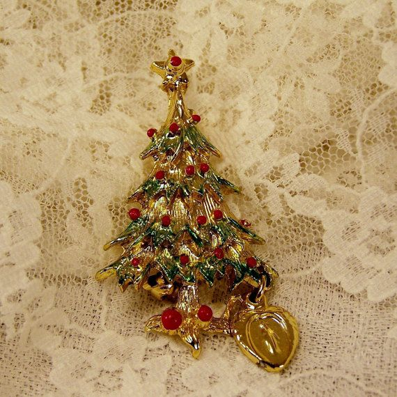 Hey, I got this one, get for $14 @ Etsy listing at https://www.etsy.com/listing/210162849/vintage-christmas-tree-gold-brooch