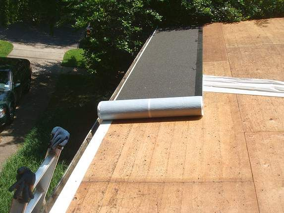 Ice And Water Shield Rolled Out On Flat Roof In