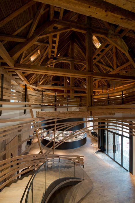 Wooden strips coil around staircase at Strasbourg hotel by Jouin ...