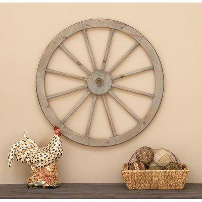 "August Grove Metal Wagon Wheel Statue Size: 30"" H x 30"" W x 2"" D"