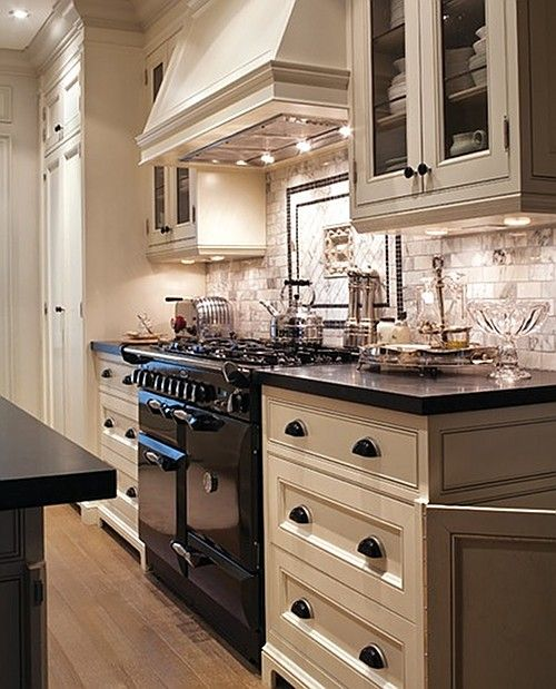 Gray Kitchen Cabinets With Black Appliances: Kitchen... Black And White Kitchen. Marble Subway Tile Back Splash. Glazed Cabinets.