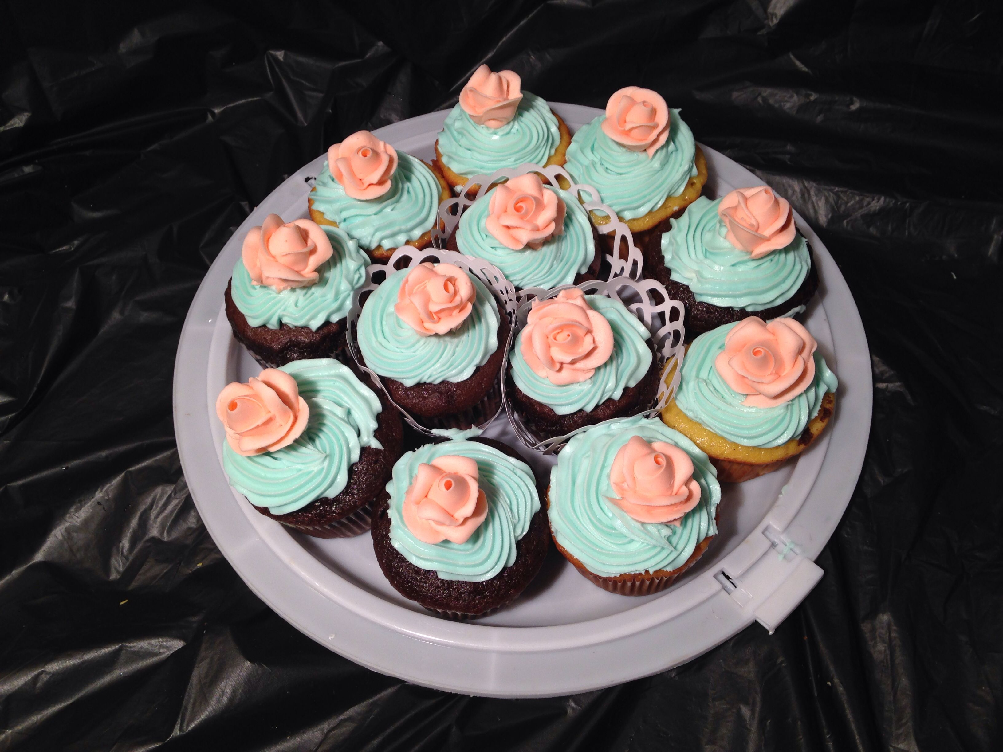 Baby shower cupcakes in aqua and coral