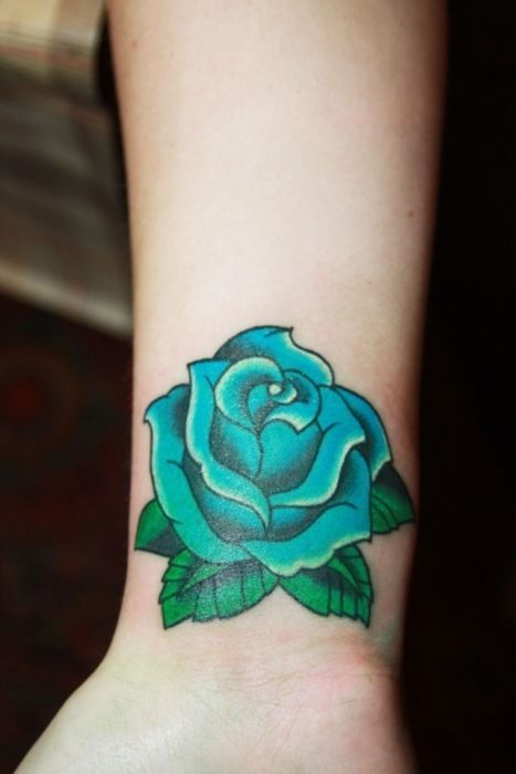 Some Cultures Believe That The Holder Of A Blue Rose Will Have Their Wishes Granted Blue Rose Tattoos Rose Tattoos Tattoos