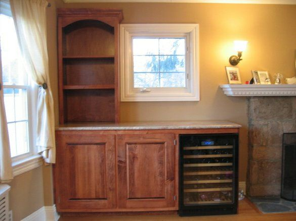 Custom Cabinet Built To Incorporate Wine Cooler With Granite Top And Hutch