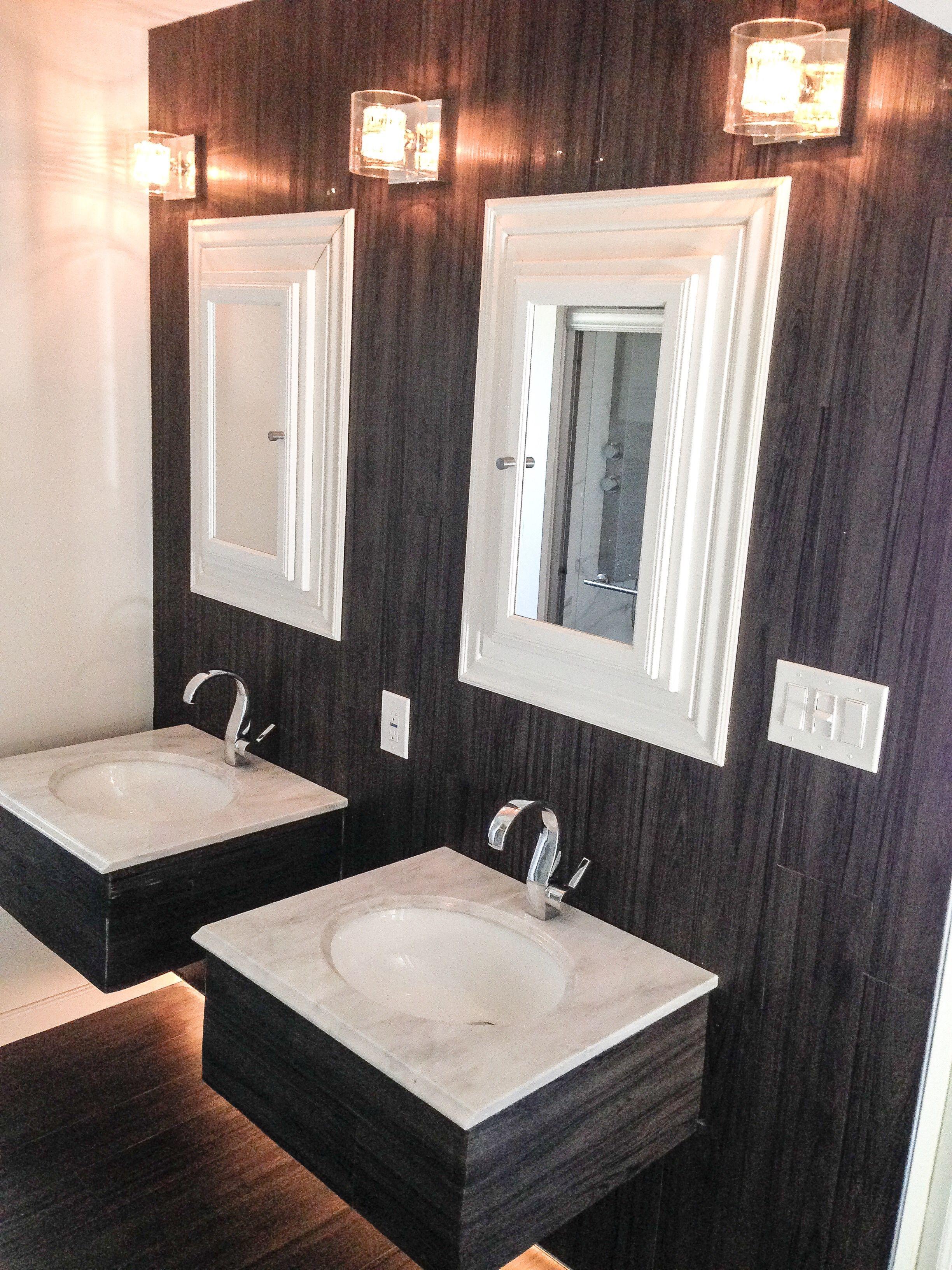Vinyl plank floor installed on wall bathroom double vanity dark