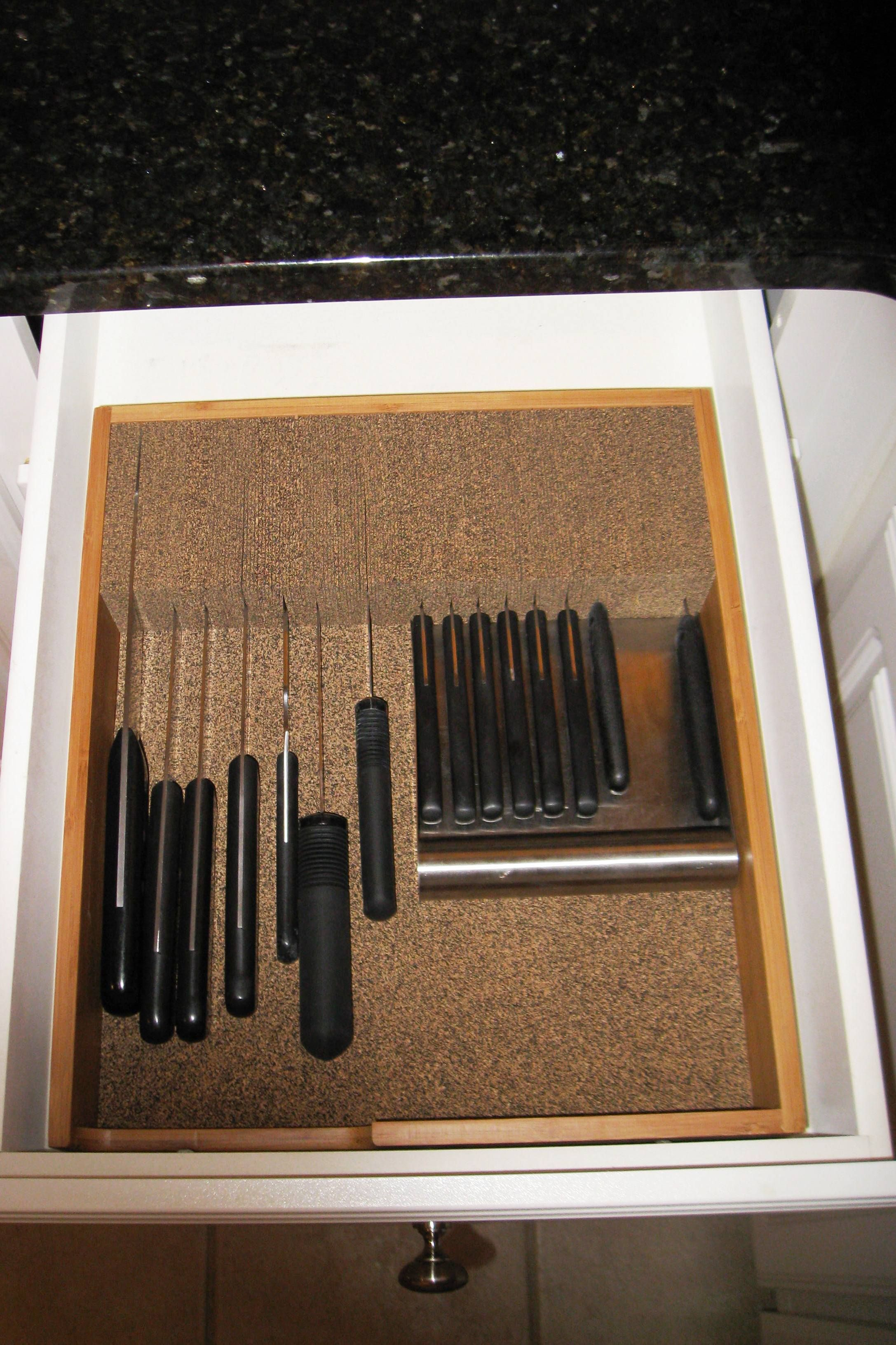 A Bamboo And Cork Knife Dock Fits Neatly Inside A Kitchen Drawer