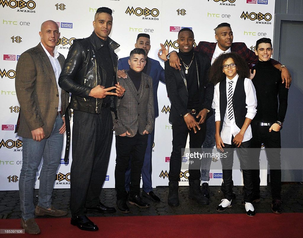 Members of street dance group Diversity pose for pictures as they arrive for the 2013 Mobo Awards in Glasgow, Scotland, on October 19, 2013.