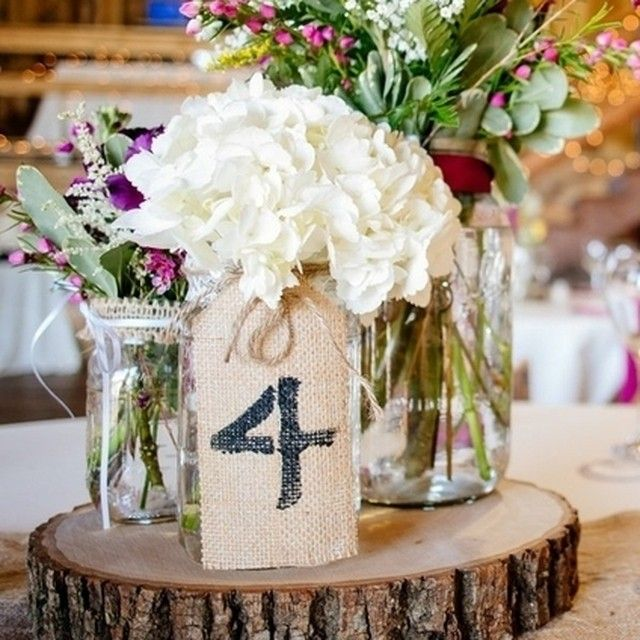 If you're into the #rustic vibe, you're gonna LOVE this centerpiece idea! Photo by @rachelsmithphotography, Featured on @rusticweddingchic. Other vendors include @blossomandbasketboutique, Karen Rodkey Cakes &  The Savory Spoon Catering. #centerpiece #weddingideas
