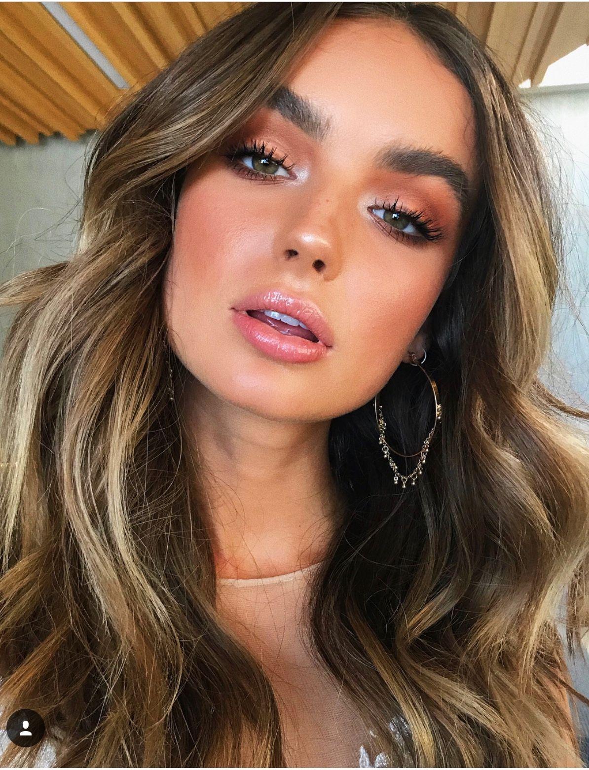 Warm brown smokey eyeshadow look with glowing bronzed skin