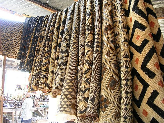 Kuba cloth (Democratic Republic of Congo) | Kuba cloth is used for ceremonial skirts, wall hangings, or sitting/sleeping mats. The cloth itself is woven from raffia palm leaves. To achieve the distinctive geometric patterns, dyed raffia threads are interwoven into the cloth. Using this technique, it takes about a month to complete a small embroidered square.