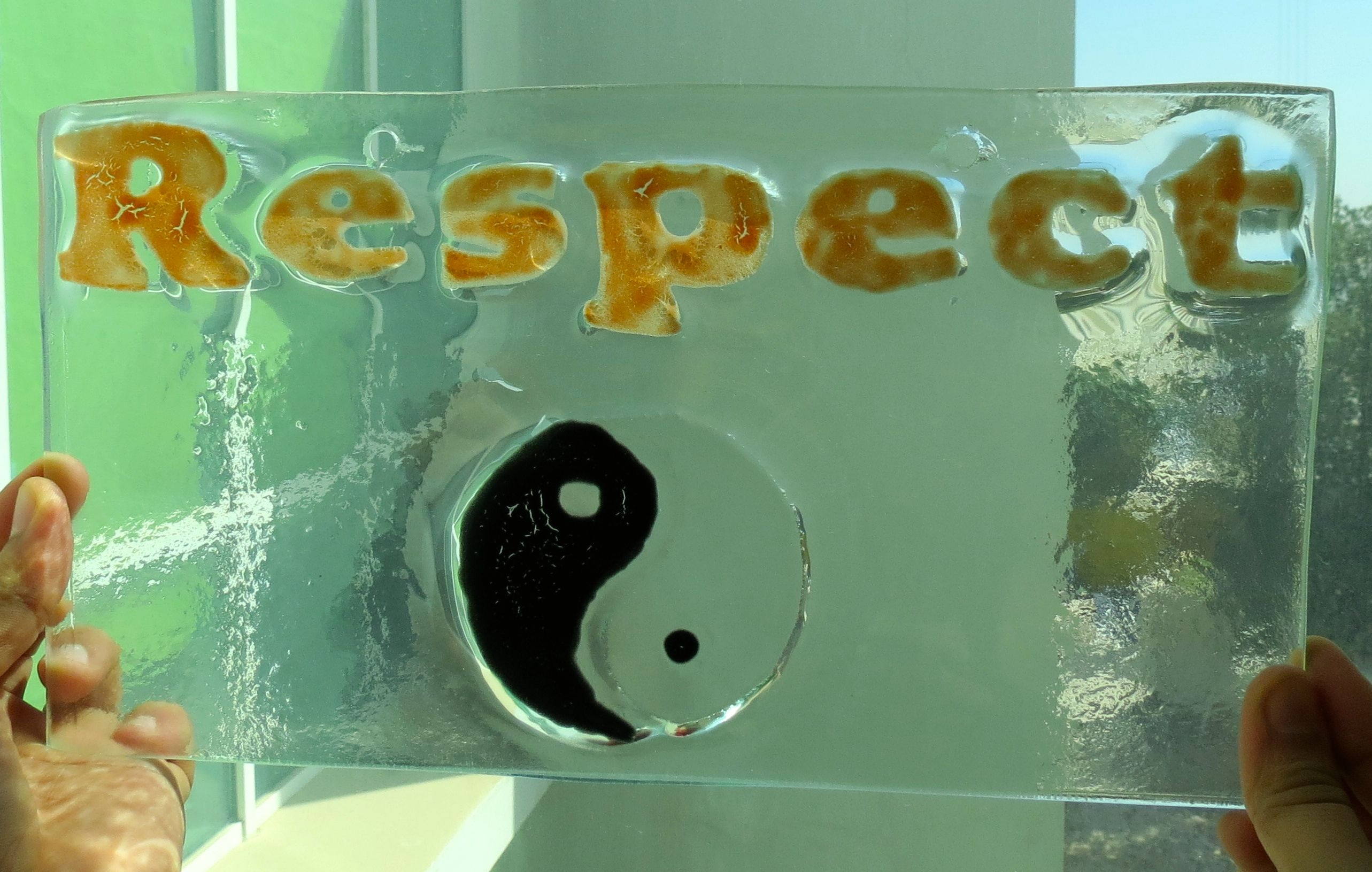Students used Glassline paint and fiber cotton to create the letters for this ASD window hanging. Respect