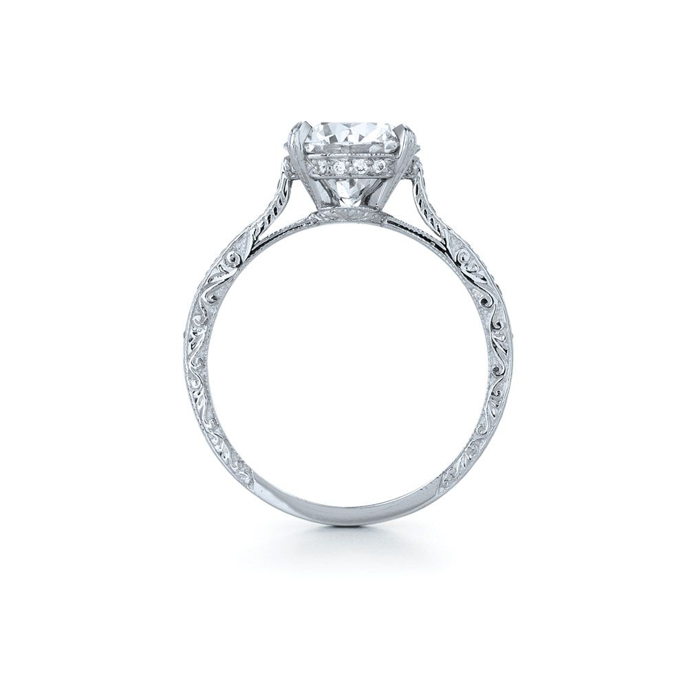 Round diamond ring in platinum with a pave diamond and hand engraved