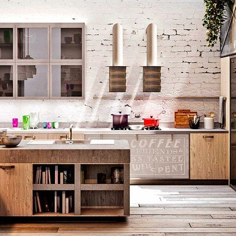 Snaidero's Code Evolution kitchen by designer Michele Marcon evokes the downtown spirit and industrial edge of an urban loft. Produced in a range of materials, the kitchen is shown here with cabinetry in Oslo Oak melamine, providing a reclaimed-wood effect, and countertops in Oak Beton melamine, which mimics cement : Architectural Digest