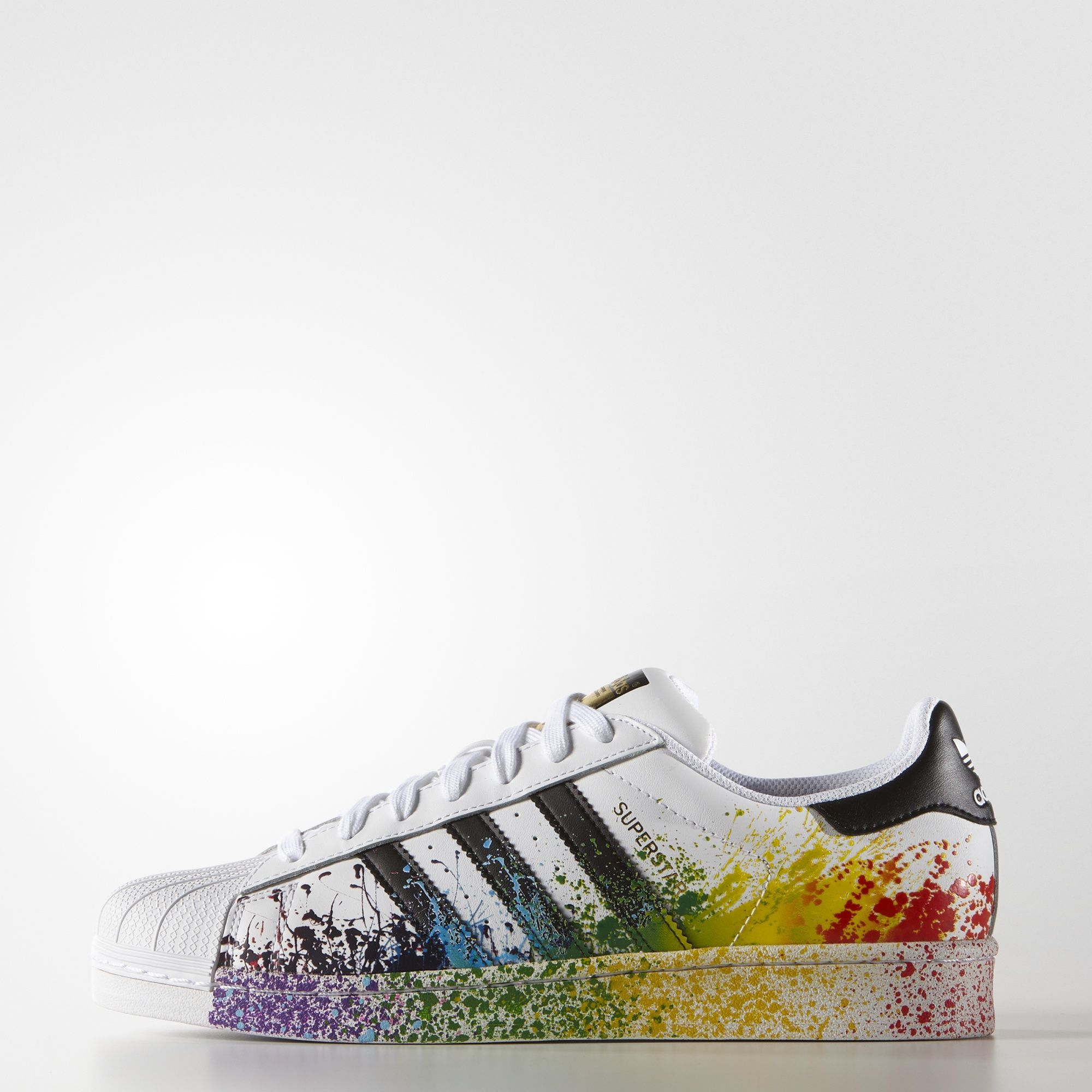 These men's adidas Superstar shoes proudly display the rainbow with an  eye-catching splatter print on the midsole and upper.