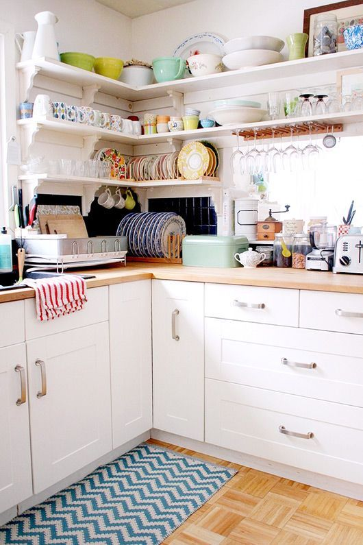 Open kitchen shelves for storage - the home of jewelry designer