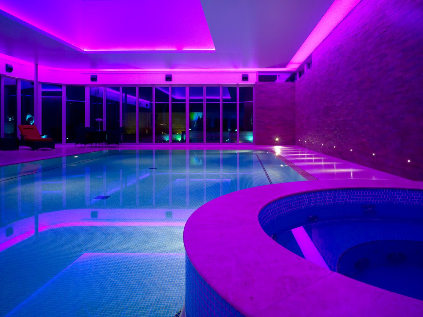 Swimming Pool. Indoor Pool Lights With Purple And Blue