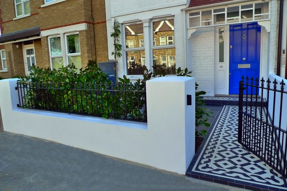 garden wall metal rails and gates modern mosaic tile path london