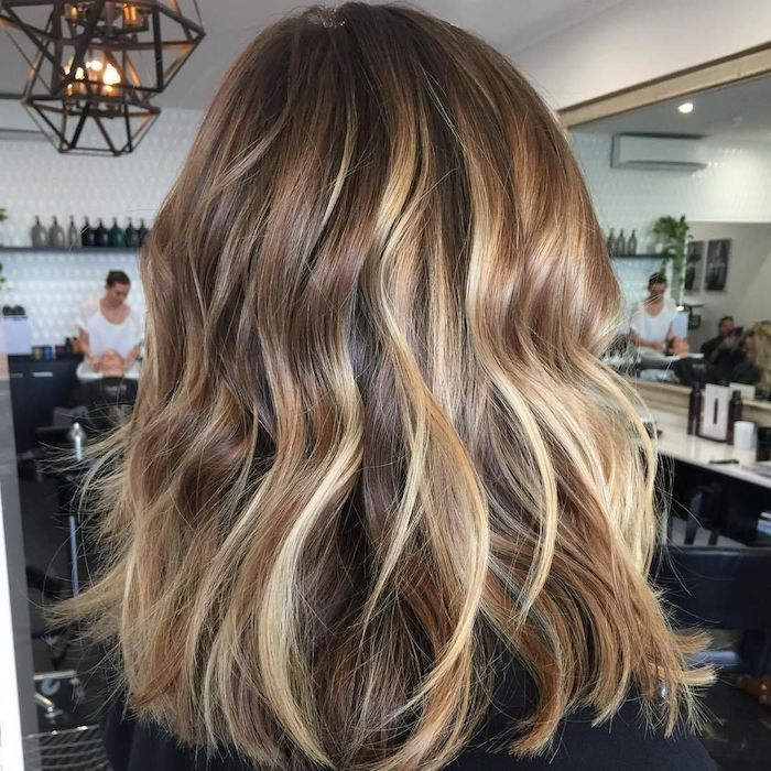 Wavy Soft Hair With Streakes In Different Shades Of Blonde And Brunet Tones Seen From The In 2020 Brown Blonde Hair Brown Hair With Blonde Highlights Blonde Highlights