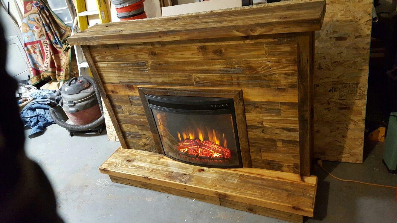 Custom built reclaimed fence paneling fireplace