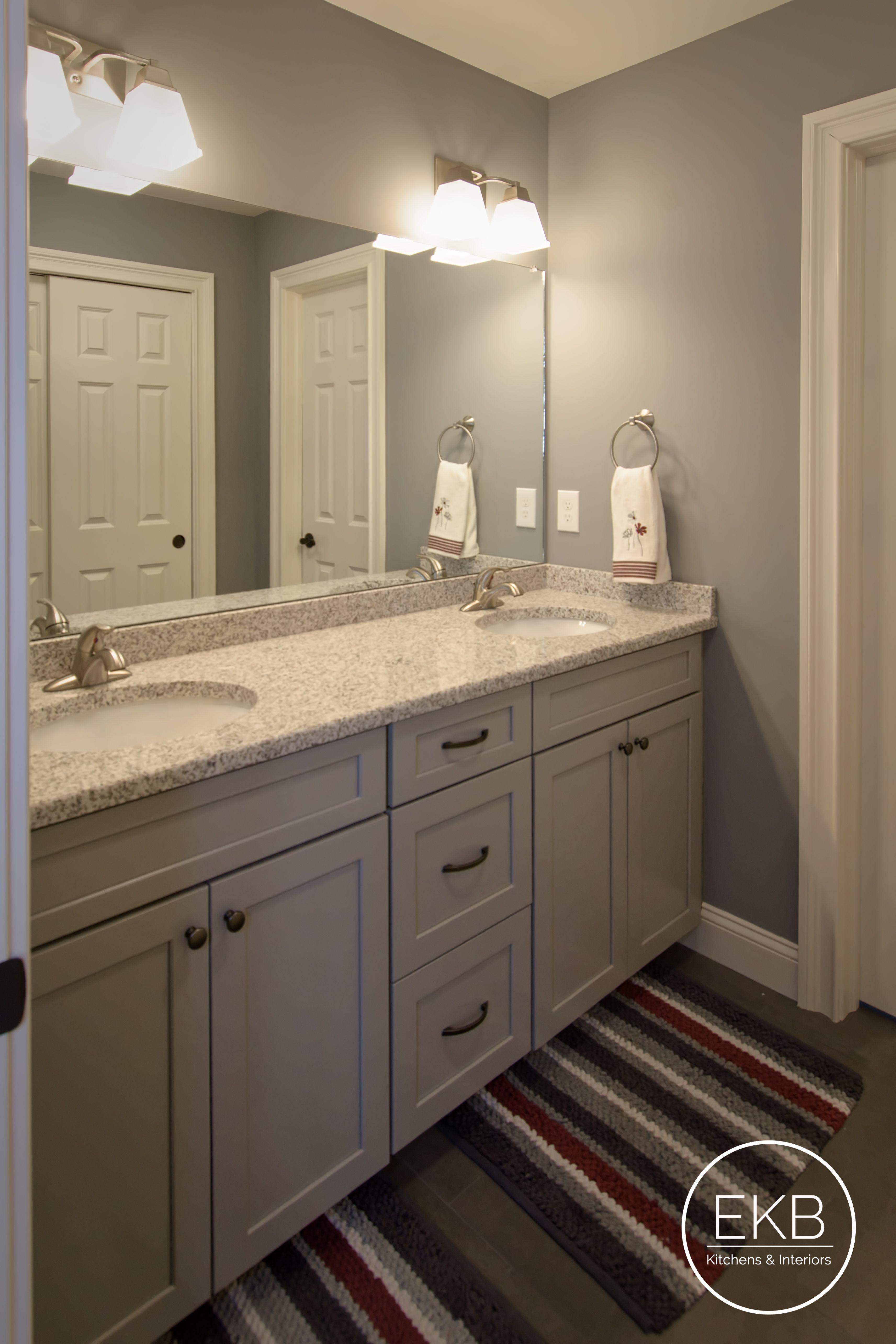 Waypoint Living Spaces 410f Painted Stone Cabinets And Luna Pearl Granite Countertops Luna Pearl Granite Granite Bathroom Granite Bathroom Countertops
