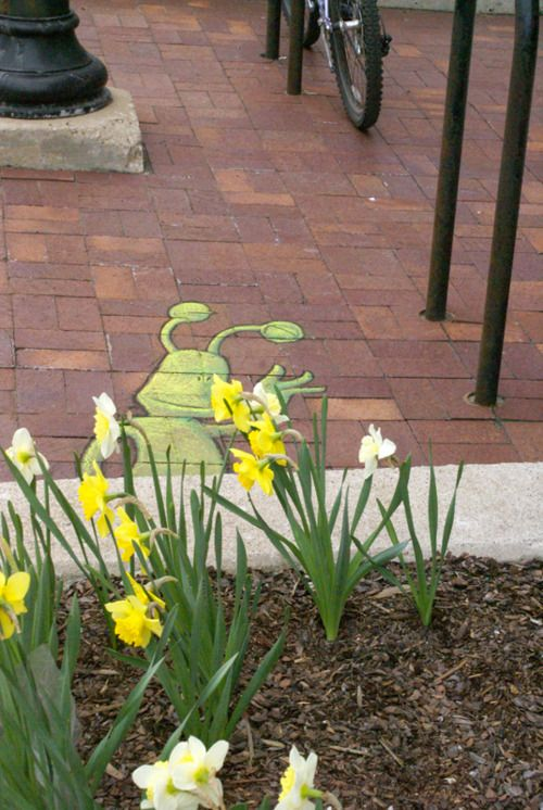 Sluggo stops to smell the flowers in Ann Arbor. David Zinn Chart art.