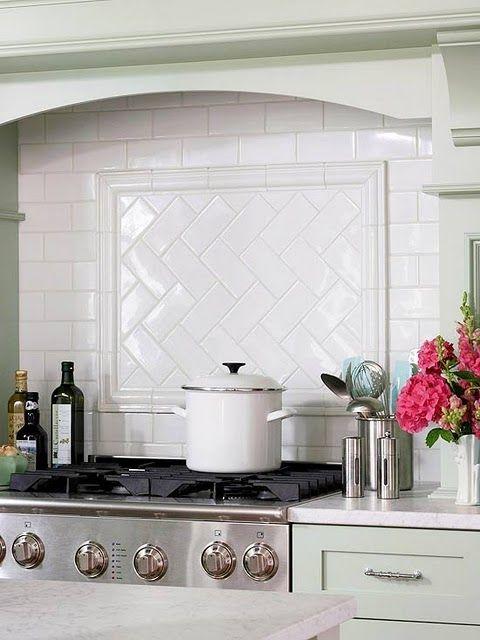 Subway tile backsplash with herringbone pattern behind stove top also no