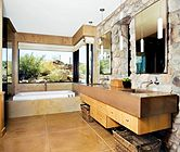 Love the rustic element of the stone with the view out the window.