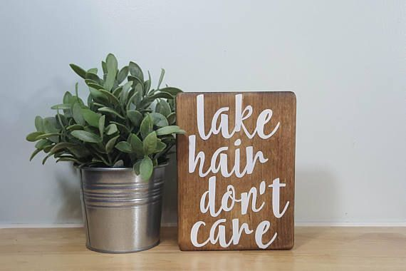 Lake hair, dont care!  Excellent decor option for a lake house bathroom! Measures 5.5 x 7.25 x .75 Walnut stain with white lettering. Each item is made to order - please see the current production time in the shop announcement. Every sign is cut, sanded, stained, and painted by our husband & wife team in our home studio. All of our signs are painted with quality acrylic paint—no vinyl—and then sealed with a matte polyurethane finish to protect it for years to come. We love the uniqu...