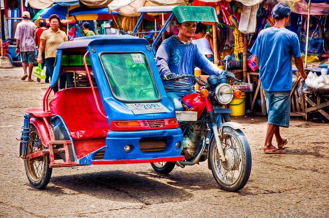 The Tricycle, a motorbike with a side-cart attached onto it