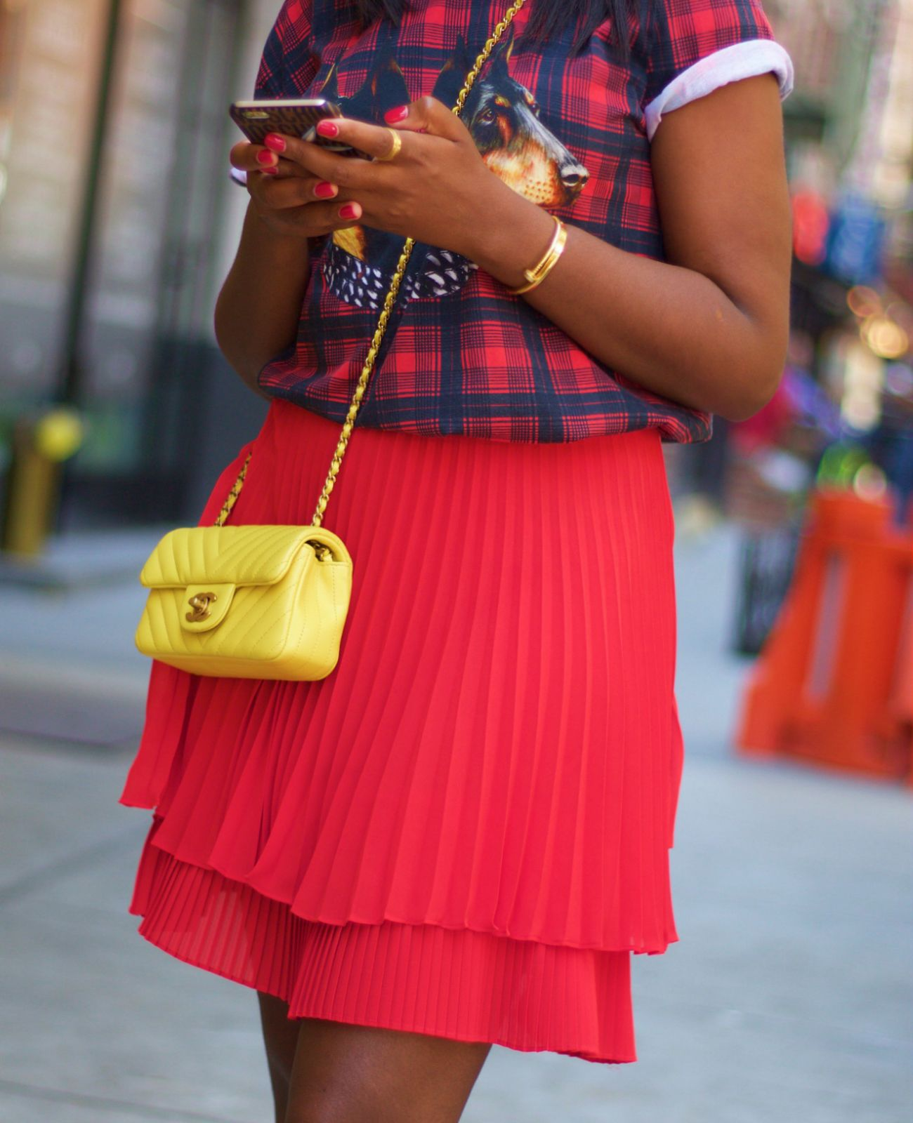 chanel yellow. yellow chanel mini and a red top shop skirt
