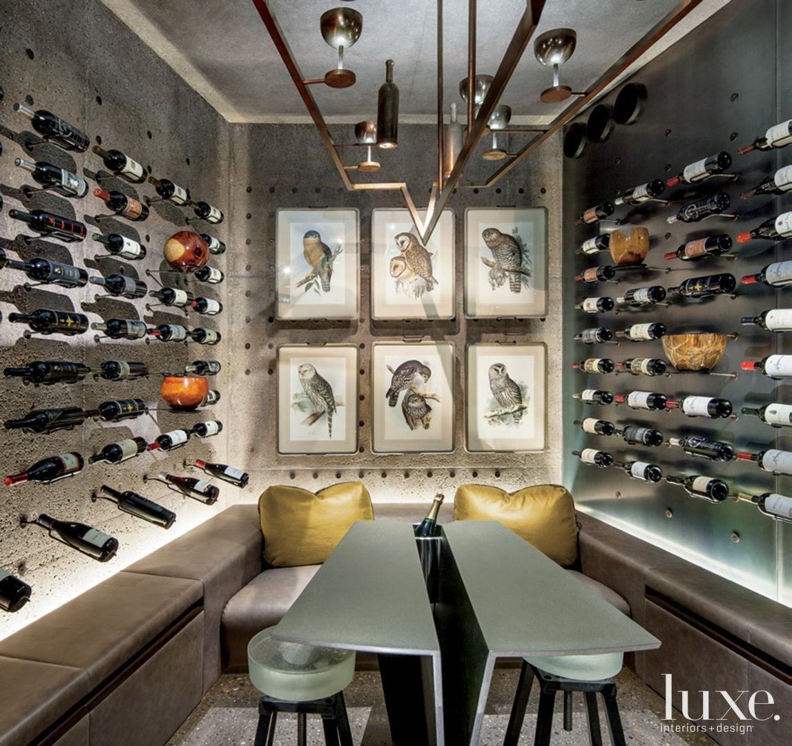 Modern neutral wine cellar with custom seating and table luxe modern gray wine room the wine rooms light fixturesporting goblets and wine bottlesas well as the seating and table were custom designed by arubaitofo Choice Image