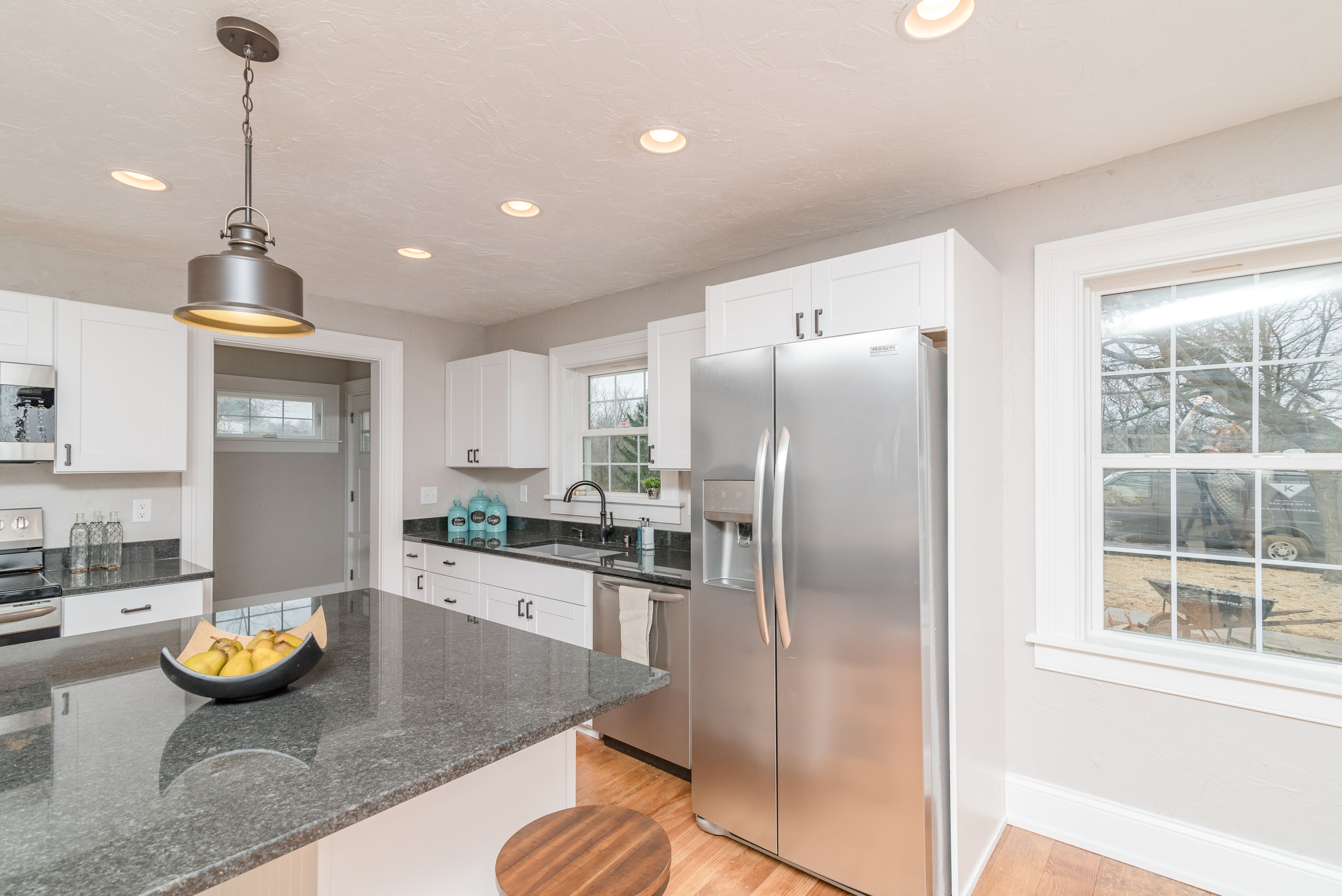 Kitchen space with black granite countertops and white