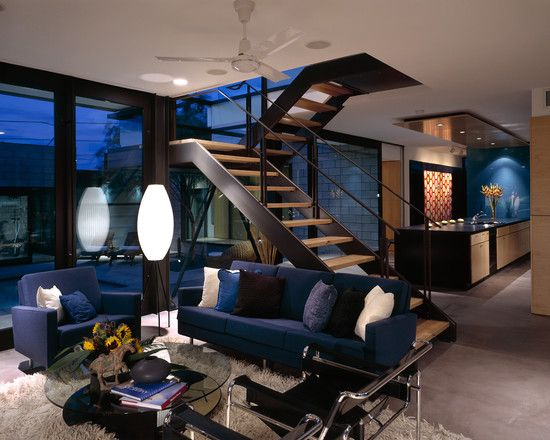 modern home furniture blue sofa white shaggy carpet interior staircase