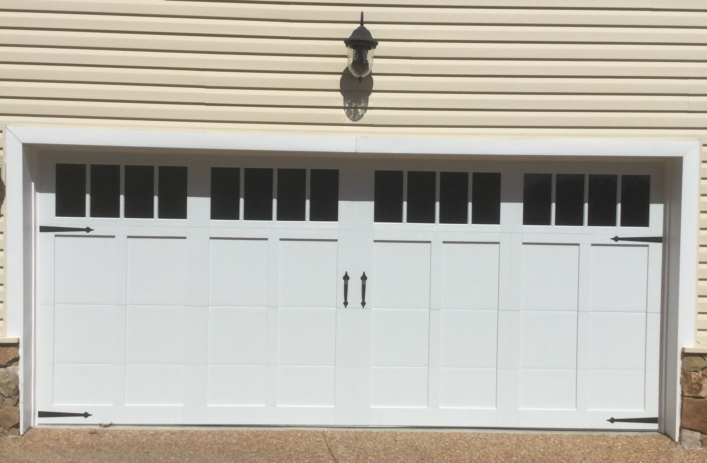 16x7 Model 5330 Carriage Style Garage Door With Top Glass And Madison Inserts Installed By The Richmond Store Carriage Style Garage Doors Doors Garage Doors