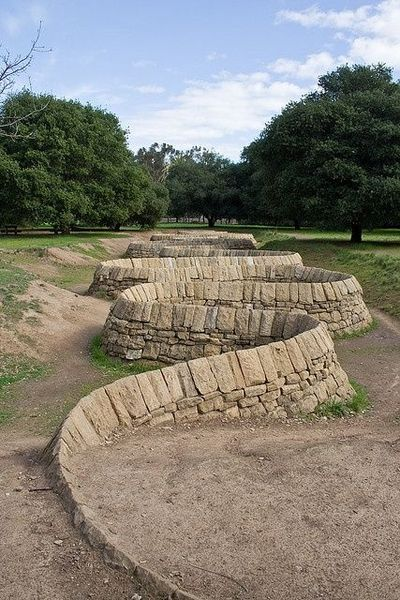 Andrew goldsworthy stone river 2002 stone walls for River rock columns
