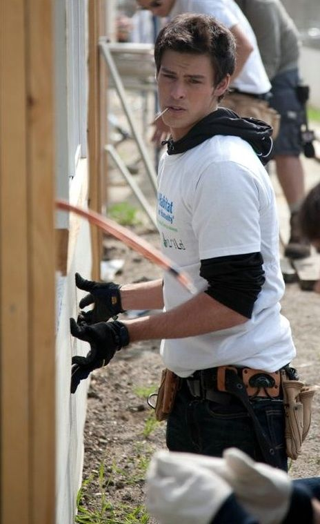 Adam Gregory (90210) helping build a home for Habitat for Humanity.