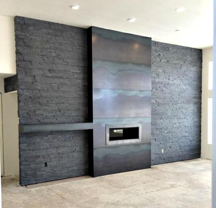 here is a candid shot of a hot rollnatural steel fireplace and mantel we did out in minot nd we went with a super clean tightly seamed