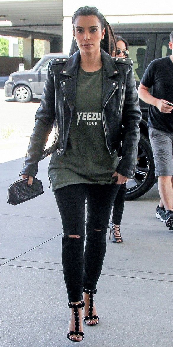 Kim Kardashian dons her hubby s Yeezus tee with super skinny tattered black  denim for a rebel look with sophistication.     Fashion 2f4e0e686e5