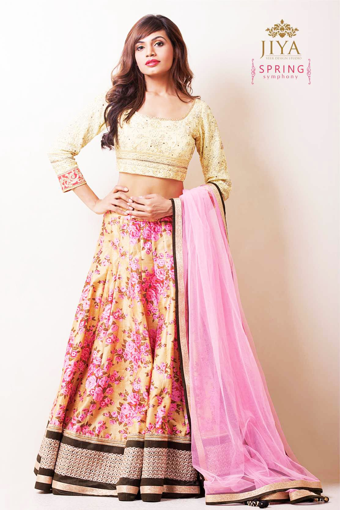 Spring symphony lehenga in beige and rose with an all over print. A lemon colored chikankari blouse completes the  contemporary look.