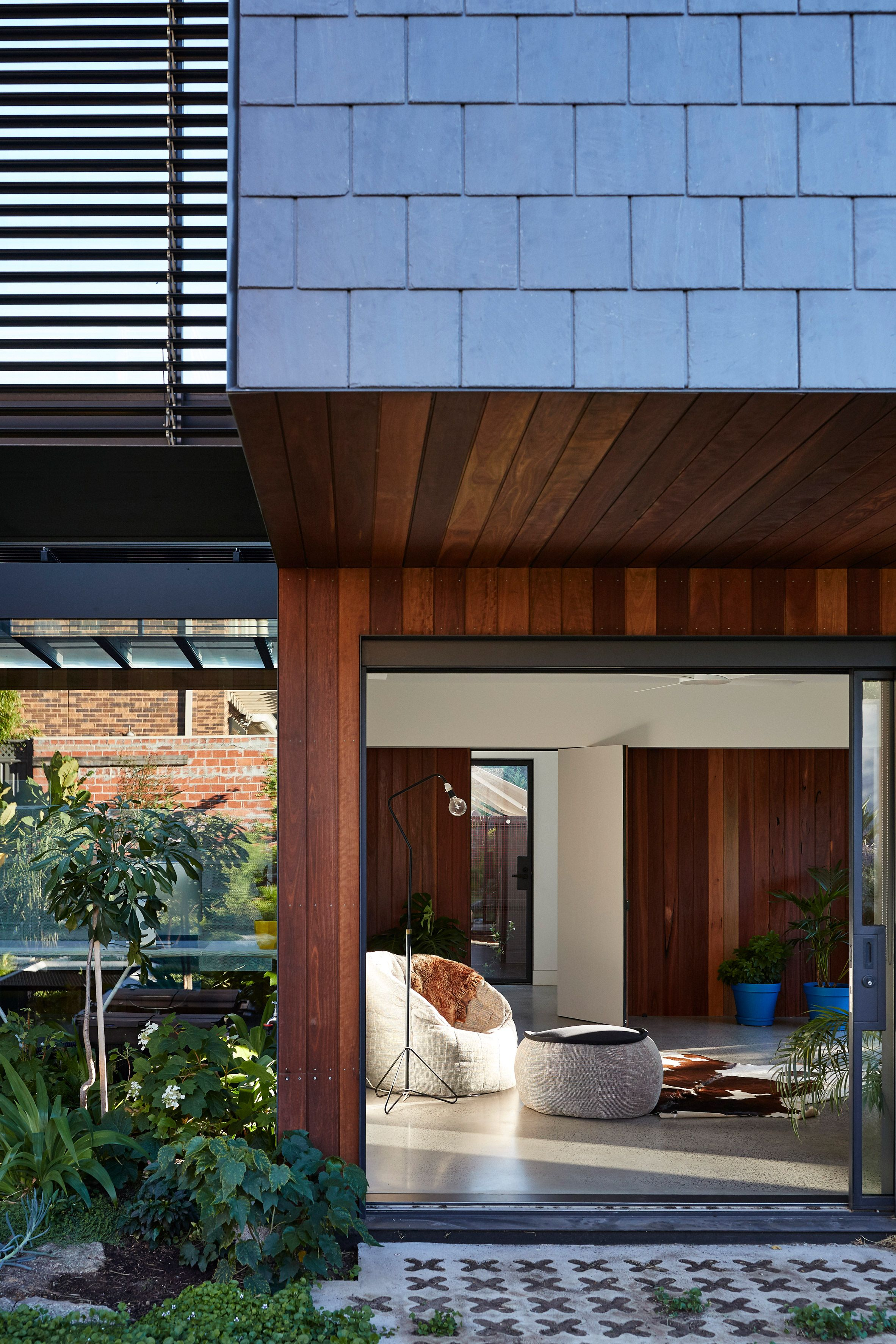 slate shingles arranged in various patterns across the outer walls of the house shaped blocks on the facade of this residence in melbourne - Slate Cafe Decoration