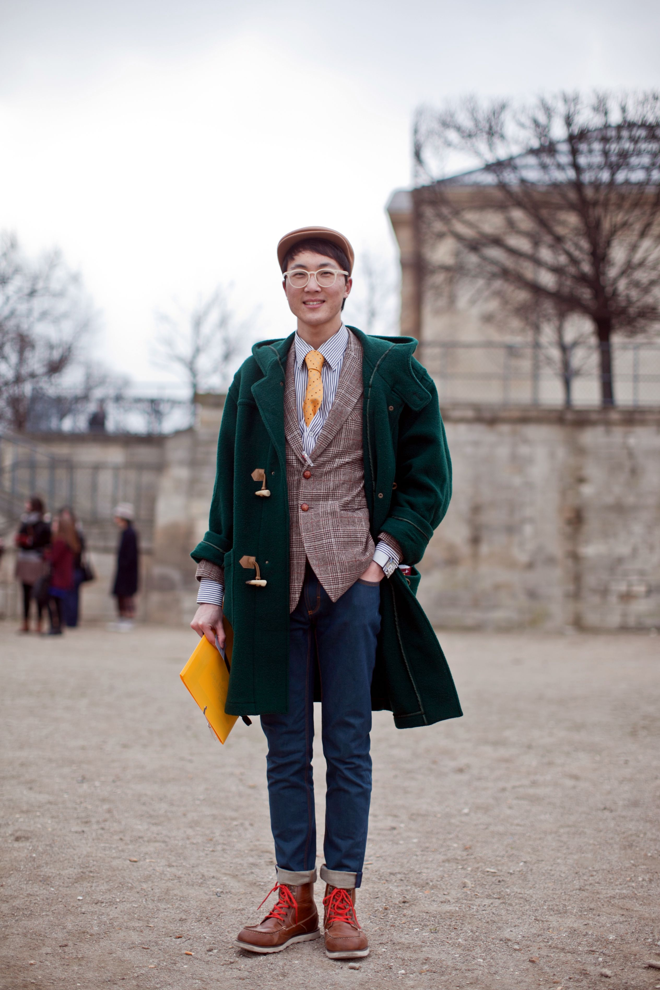 Are These The World's Best Dressed Men? #refinery29 http://www.refinery29.com/mens-fashion-week/street-style#slide38 Team up your folio with your tie to really make a toggle coat/hiking boot combo pop. Photographed by Christian Vierig