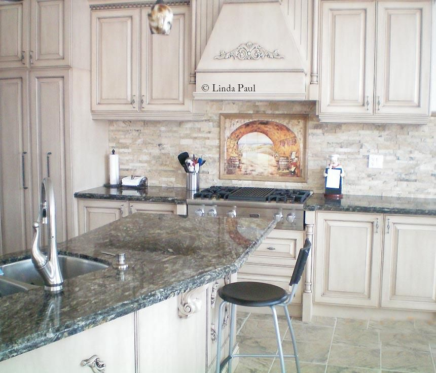 everything tuscany mural with italian chef in stacked stone backsplash