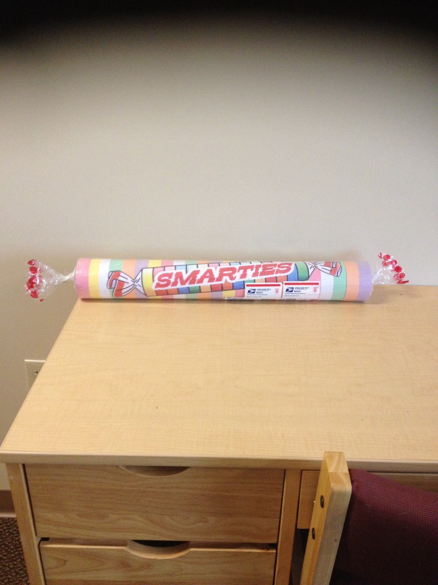 Cute care package made from mailing tube and decorated